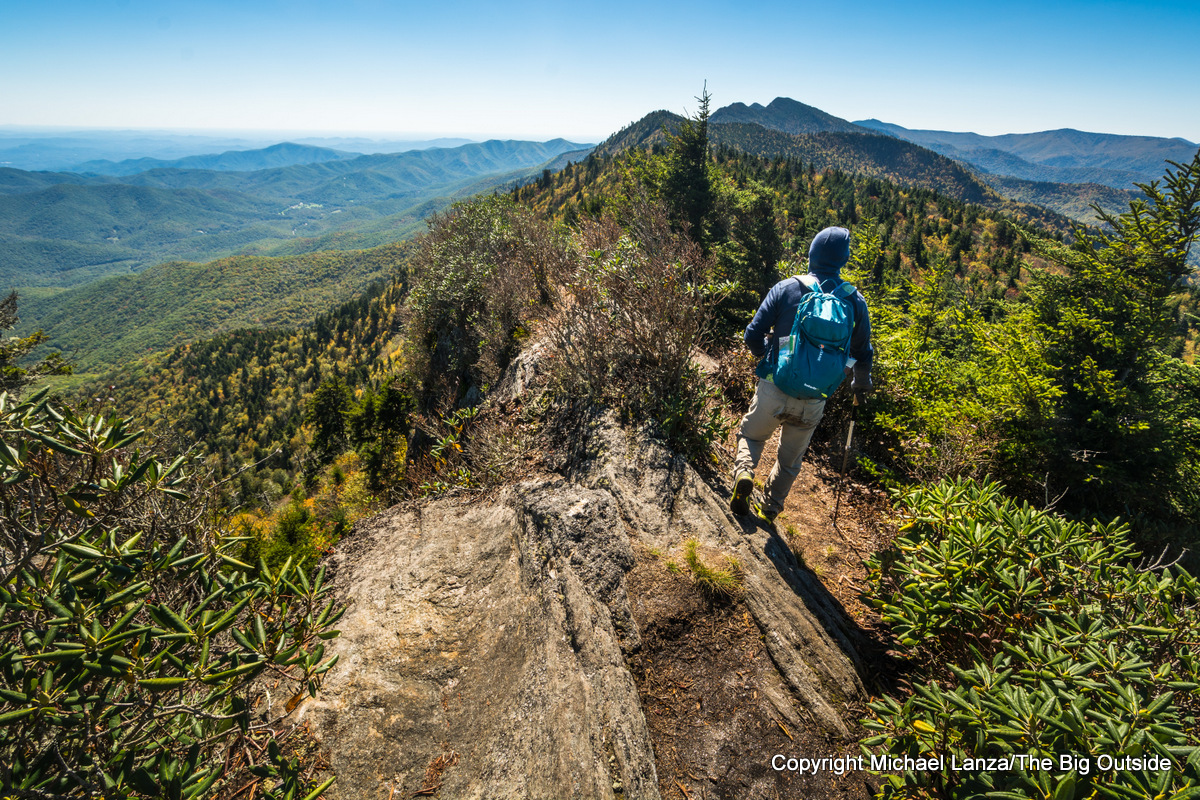 A hiker on the Black Mountain Crest Trail up Mount Mitchell, N.C.