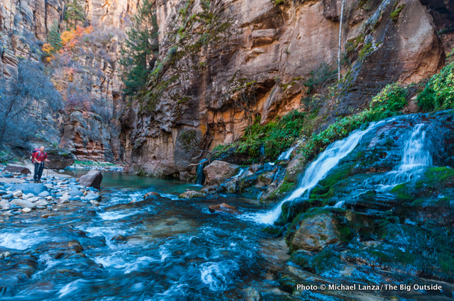 A backpacker at Big Spring in The Narrows, Zion National Park.