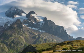 Trekkers below the Aiguille des Glaciers on the Tour du Mont Blanc.