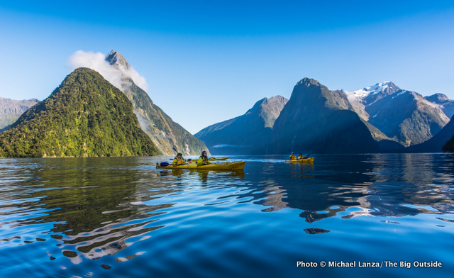Kayakers in Milford Sound, Fiordland National Park, New Zealand.