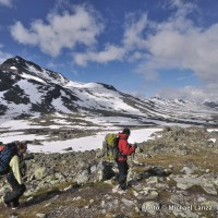 Trekkers above Olavsbu Hut in Norway's Jotunheimen National Park.