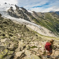 A hiker descending off the Fenetre d'Arpette on the Tour du Mont Blanc in Switzerland.