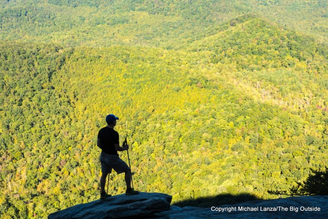 A hiker atop Looking Glass Rock, Pisgah National Forest, N.C.