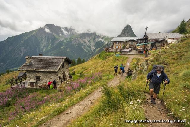 Jeff passing the Refugio Bertone on the Tour du Mont Blanc, Italy.