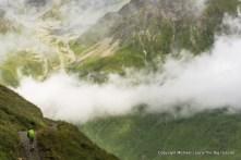 A trekker hiking to la Peule on the Tour du Mont Blanc in Switzerland.
