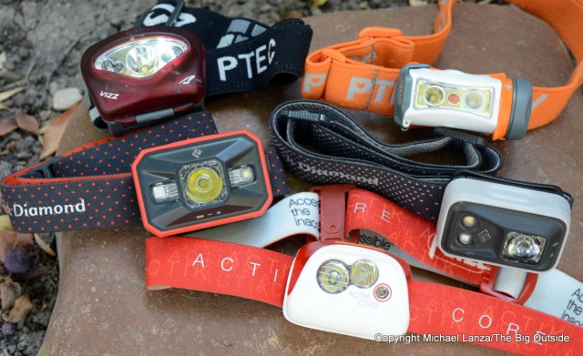 The Princeton Tec Vizz and Sync, Black Diamond Storm and Spot, and Petzl Actik Core headlamps.