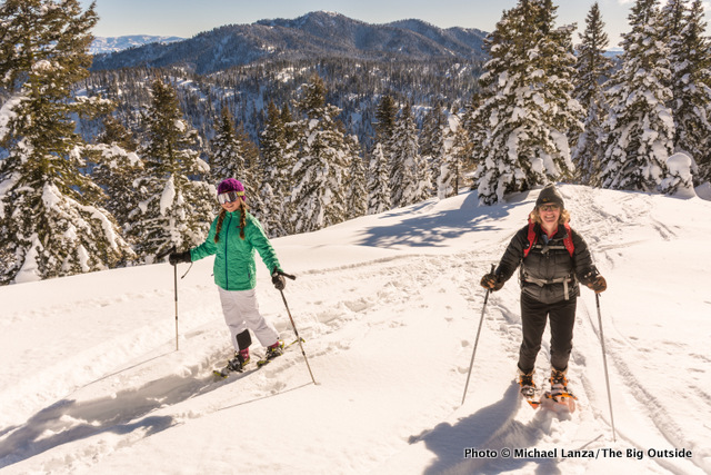 Woman and girl snowshoeing in Idaho's Boise Mountains.