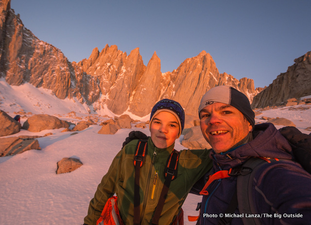 Father and son climbers hiking toward California's Mount Whitney.