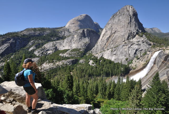 A hiker on the John Muir Trail above Nevada Fall in Yosemite.