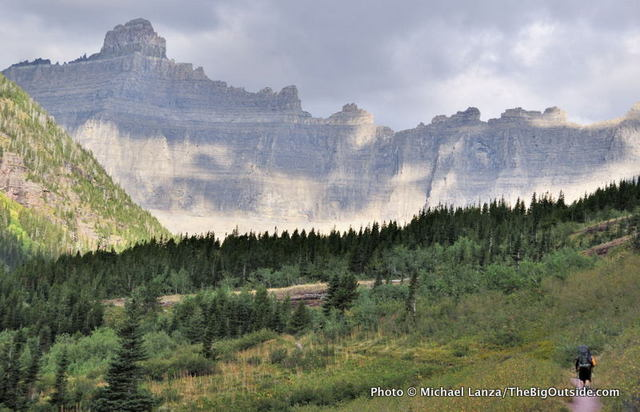 A backpacker on the Ptarmigan Tunnel Trail, Glacier National Park.