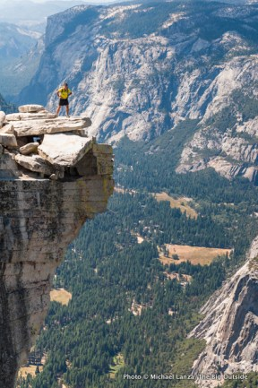 "A hiker on ""The Visor"" of Half Dome in Yosemite."