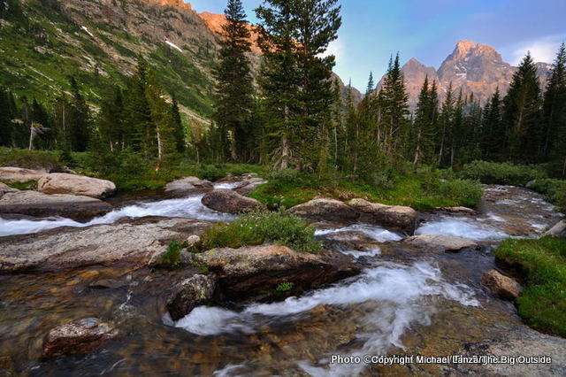 The Grand Teton bathed in evening light above the North Fork Cascade Canyon, Grand Teton National Park.