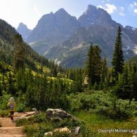 Young boy hiking down the North Fork of Cascade Canyon, Grand Teton National Park.