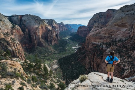 A boy hiking Angels Landing in Zion National Park.