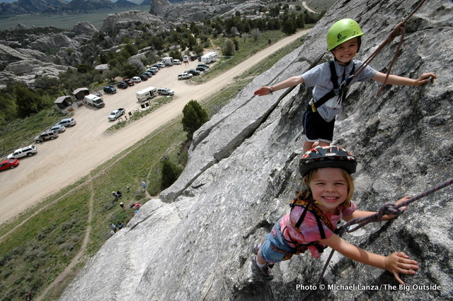 Two preschool children rock climbing at Idaho's City of Rocks National Reserve.