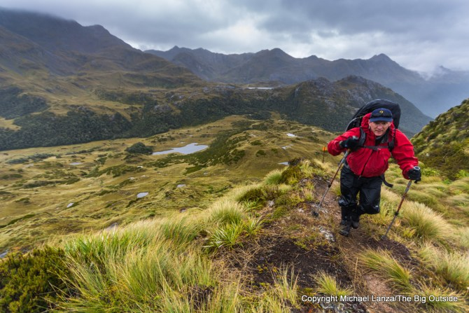 A backpacker on the Dusky Track in the Pleasant Range, Fiordland National Park, New Zealand.