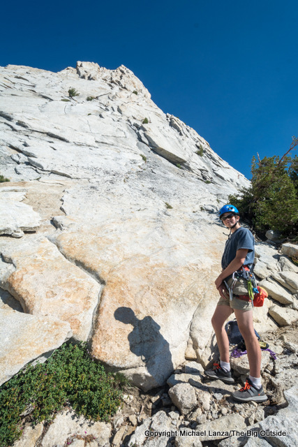 Young rock climber below Cathedral Peak in Yosemite National Park.