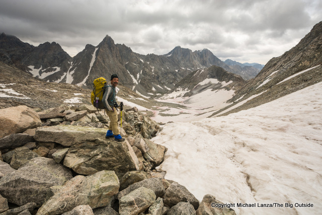 A backpacker at 12,240-foot Knapsack Col, Wind River Range, Wyoming.