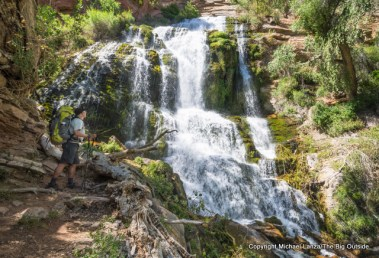 A backpacker at the Thunder River spring and waterfall in the Grand Canyon.