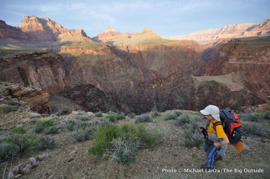 A young boy backpacking the Tonto Trail in the Grand Canyon.