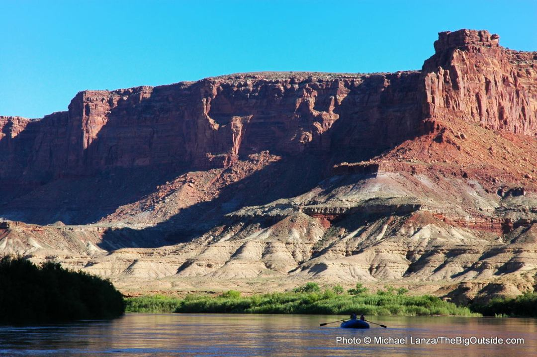 A raft floating the Green River through Stillwater Canyon in Canyonlands National Park.