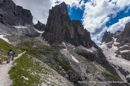 A family trekking the Alta Via 2 in Parco Naturale Paneveggio Pale di San Martino, in Italy's Dolomite Mountains.