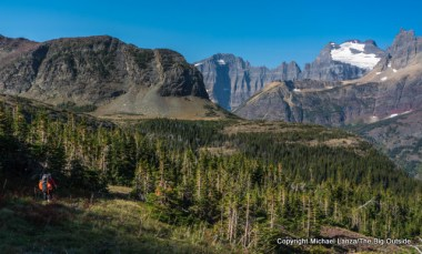 A backpacker hiking to Redgap Pass in Glacier National Park.