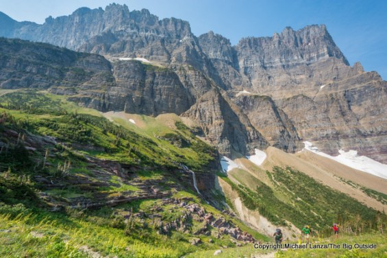Morning Eagle Falls, the Garden Wall, and backpackers on the Continental Divide Trail in Glacier National Park.