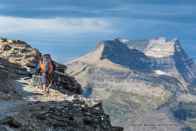 A backpacker on the Pitamakan Pass-Dawson Pass traverse in Glacier National Park.