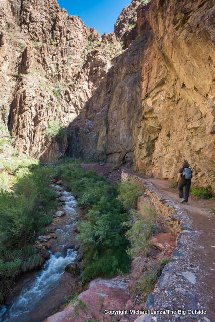 A hiker on the lower North Kaibab Trail in the Grand Canyon.