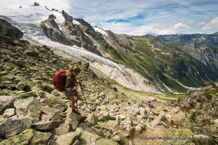 A teenage girl hiking down off the Fenetre d'Arpette, a high pass in Switzerland on an alternate route of the Tour du Mont Blanc.