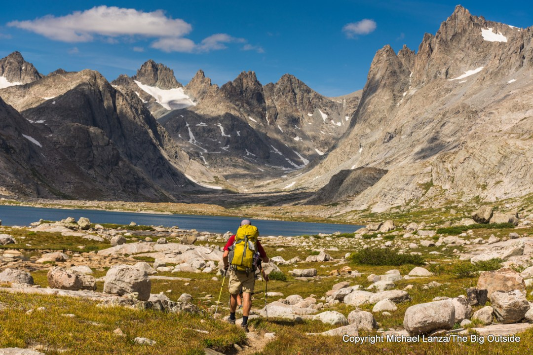 A backpacker hiking into Titcomb Basin in the Wind River Range, Wyoming.