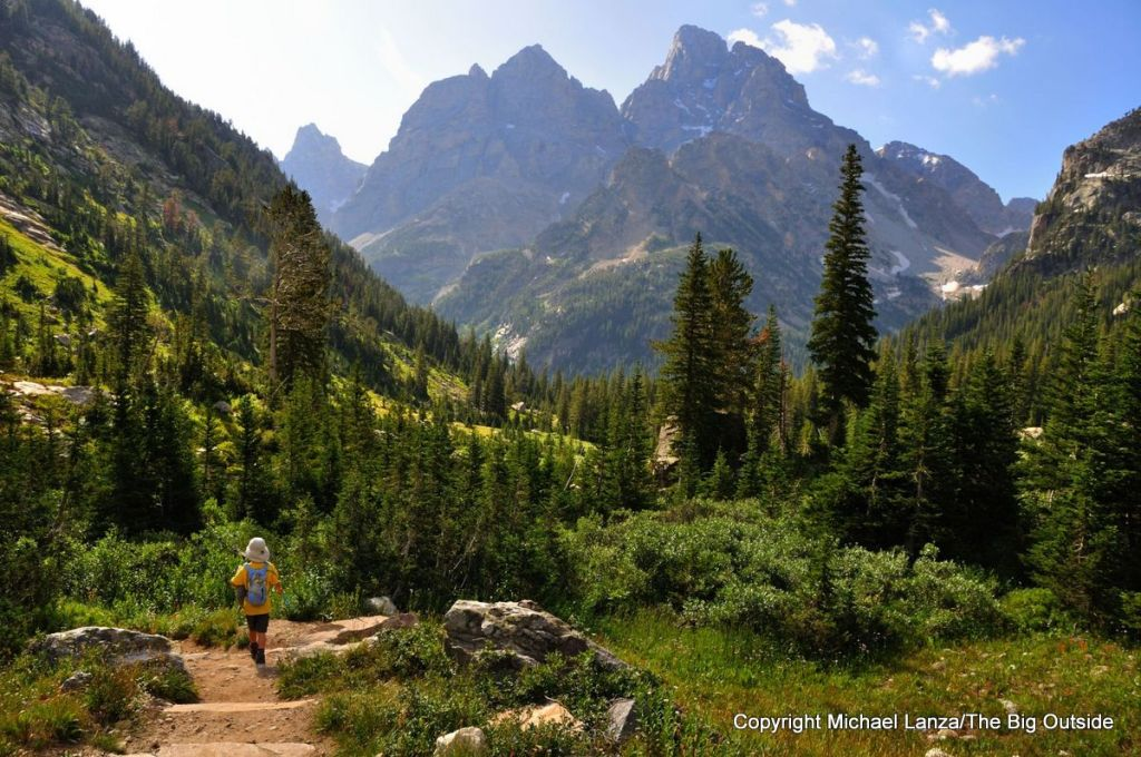 A young boy hiking in the North Fork Cascade Canyon in Grand Teton National Park.