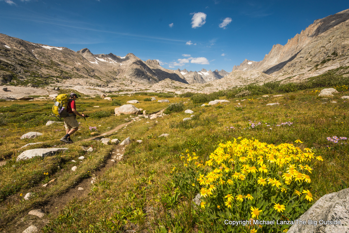 A lightweight backpacker on the Titcomb Basin Trail in Wyoming's Wind River Range.