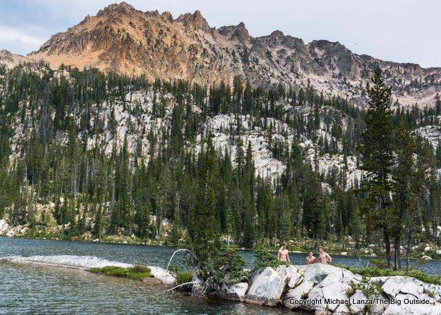 Teenage boys swimming in an alpine lake in Idaho's Sawtooth Mountains.