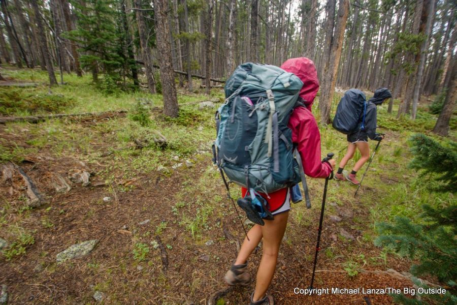 Backpackers hiking through rain in Utah's High Uintas Wilderness.