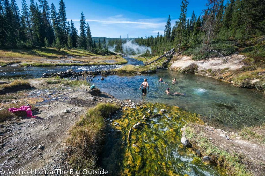 Backpackers soaking in the hot springs-fed Mr. Bubble pool in the backcountry of Yellowstone National Park.