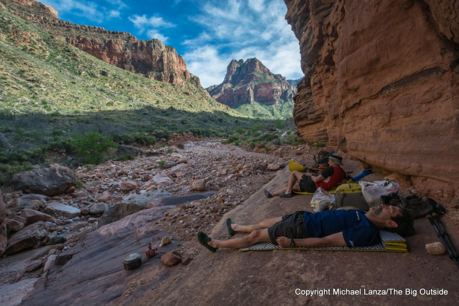Backpackers relaxing in the shaded campsite at Hance Creek in the Grand Canyon.
