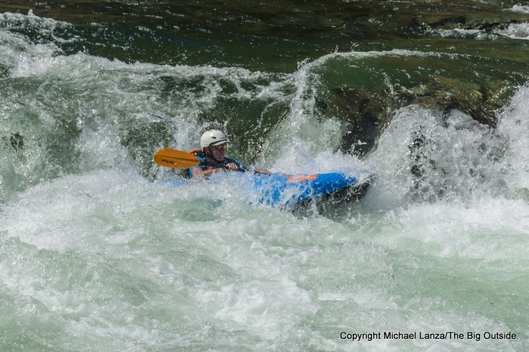 Paddling a ducky over Tappan Falls on the Middle Fork Salmon River, Idaho.