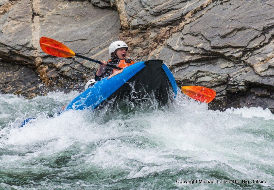 Paddlers taking an inflatable kayak through Cliffside Rapid, Middle Fork Salmon River, Idaho.