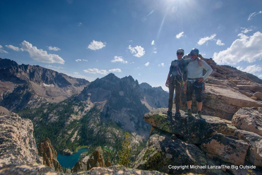 Two rock climbers atop the Elephant's Perch in Idaho's Sawtooth Mountains.