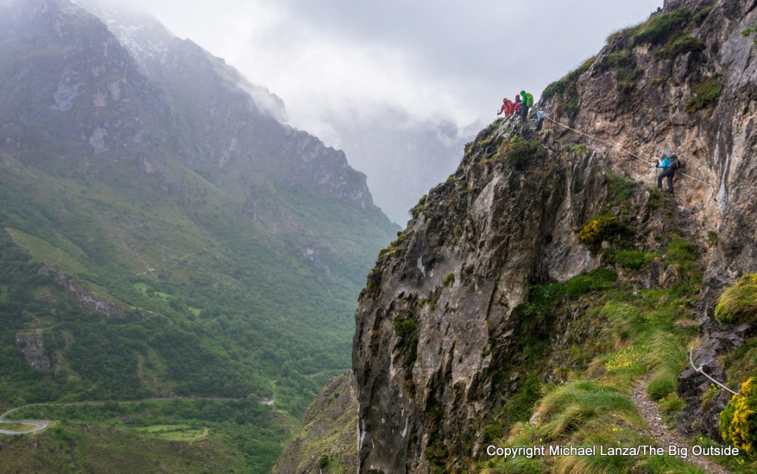 Hikers on the trail from Cordiñanes to the Refugio Collado Jermoso, Picos de Europa National Park, Spain.