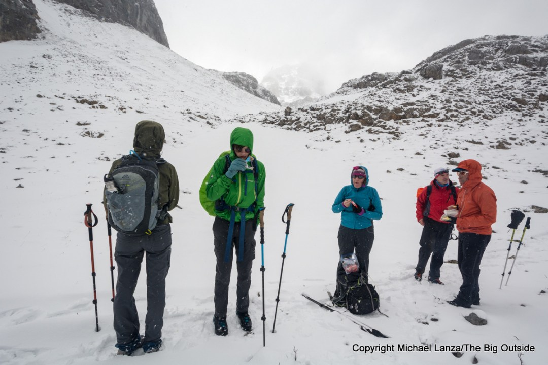 Hikers in a snowstorm on the trail from Cordiñanes to the Refugio Collado Jermoso, Picos de Europa National Park, Spain.