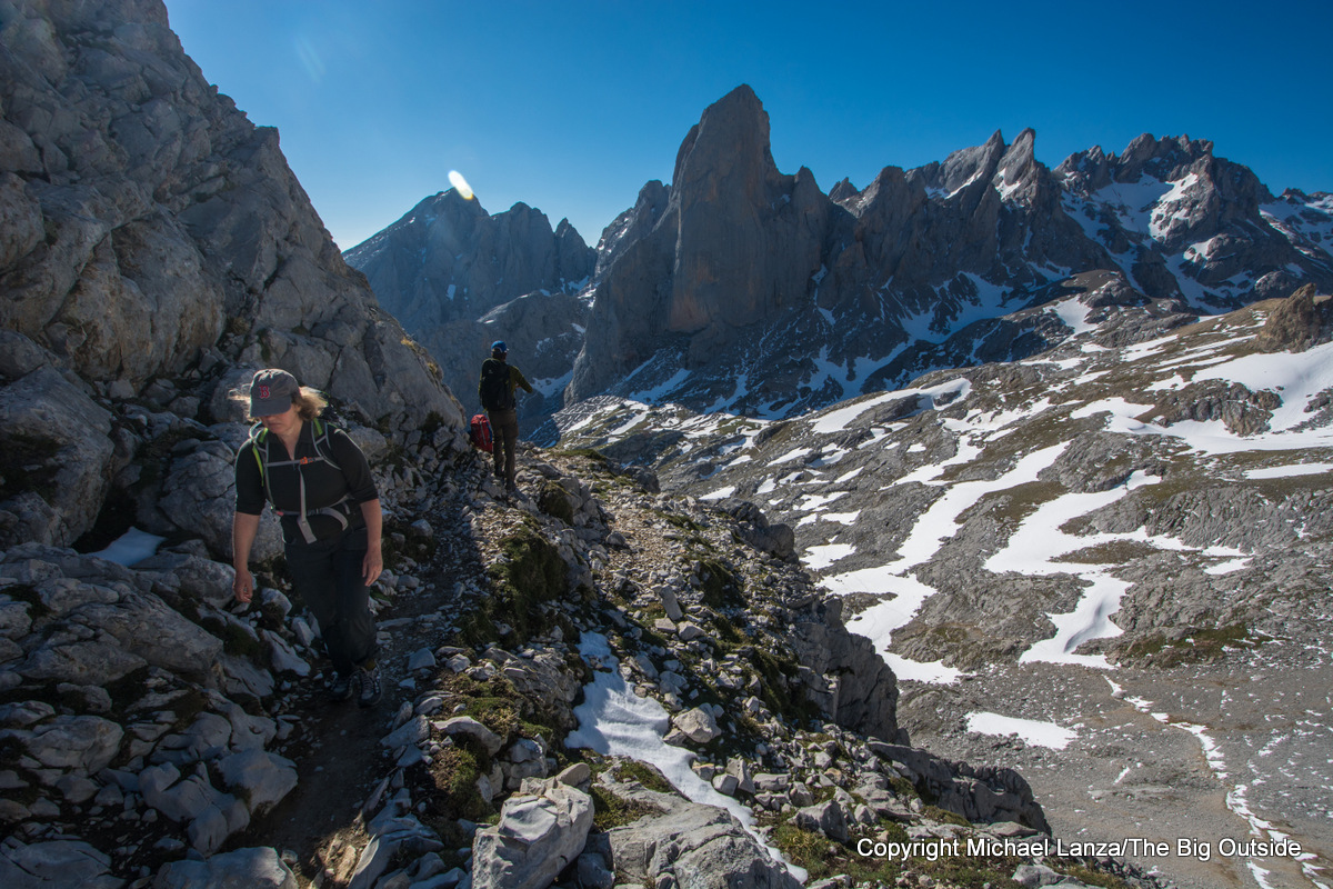 Trekkers hiking toward the Refugio Jou de Cabrones in Spain's Picos de Europa National Park.