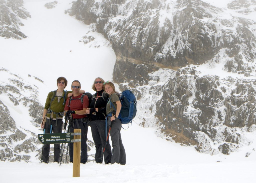 A family trekking through Spain's Picos de Europa National Park.