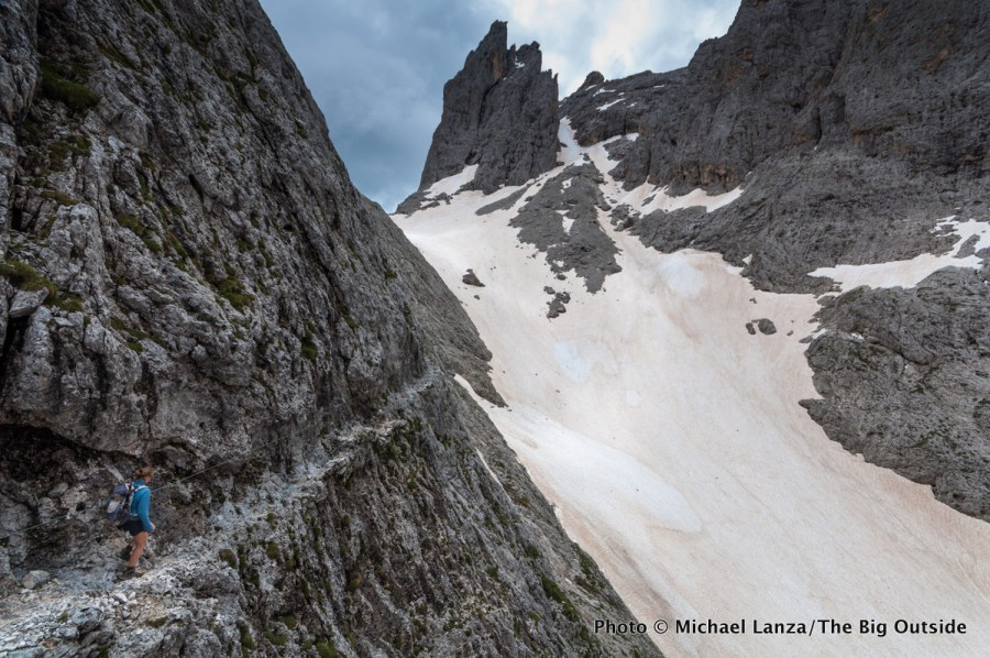 A trekker on the Alta Via 2 north of Ball Pass in Parco Naturale Paneveggio Pale di San Martino, Dolomite Mountains, Italy.