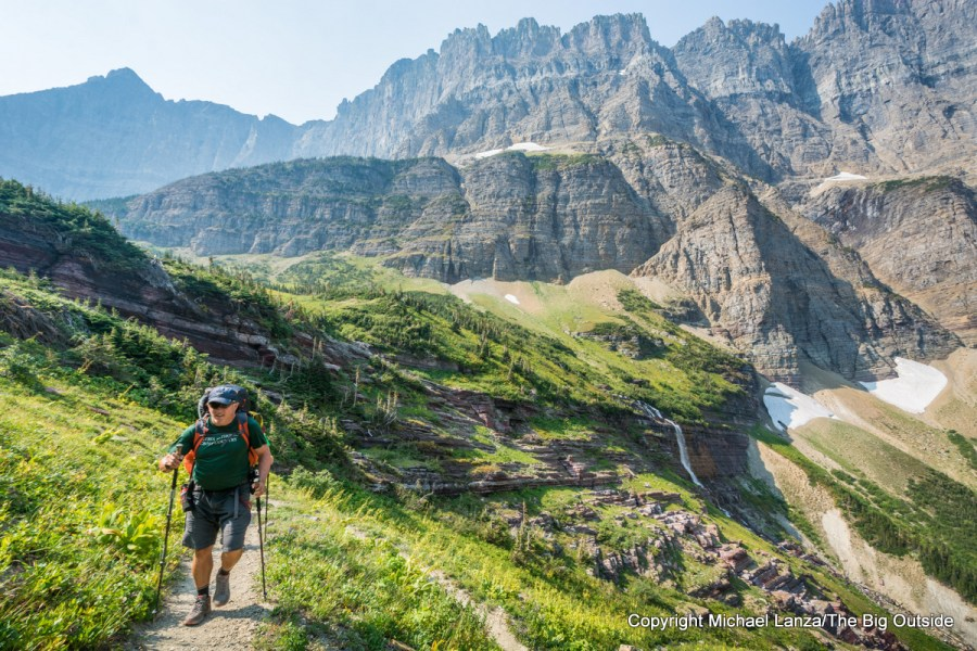 A backpacker hiking the Piegan Pass Trail in Glacier National Park.