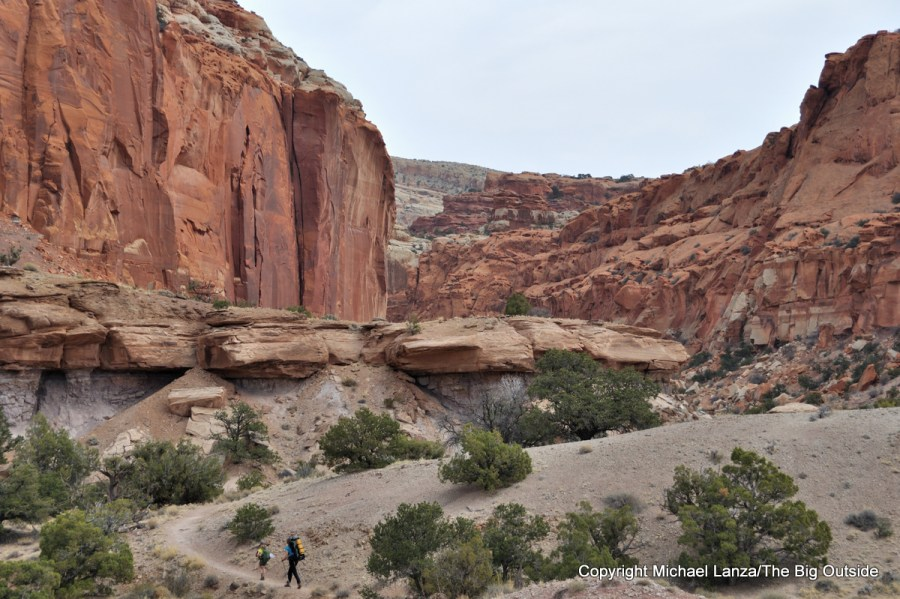 A mother and young daughter hiking Chimney Rock Canyon in Capitol Reef National Park.