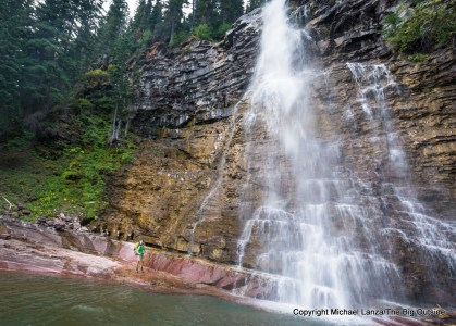 A backpacker below Virginia Falls in Glacier National Park.