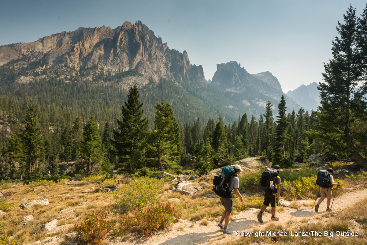 Teenage boys backpacking Trail 101 up the Redfish Valley, Sawtooth Mountains, Idaho.